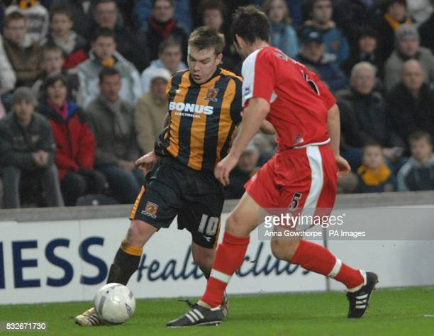 Hull City's Stephen McPhee attempts to get past Middlesbrough's Chris Riggott