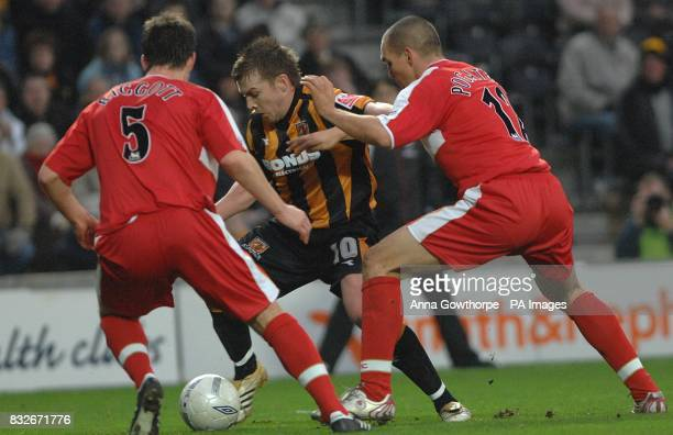 Hull City's Stephen McPhee attempts to get past Middlesbrough's Chris Riggott and Emanuel Pogatetz