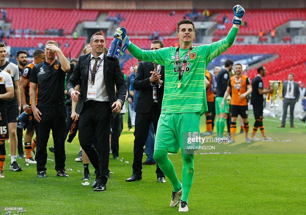 Hull City's Swiss goalkeeper Eldin Jakupovic (C) Hull celebrates after Hull City won the English Championship play-off final football match between Hull City and Sheffield Wednesday at Wembley Stadium in London on May 28, 2016. Hull City secured promotion to the Premier League with a 1-0 victory in the Championship play-off final at Wembley against Yorkshire rivals Sheffield Wednesday. / AFP / Ian Kington / NOT