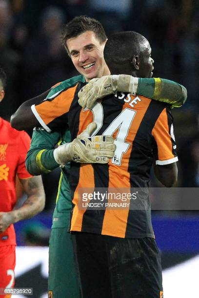 Hull City's Swiss goalkeeper Eldin Jakupovic L0 celebrates with Hull City's Senegalese striker Oumar Niasse on the pitch after the English Premier...