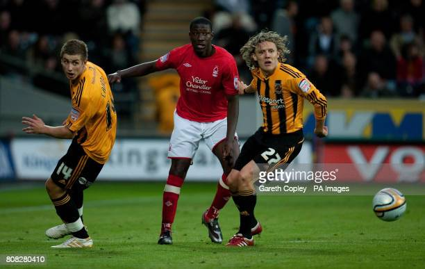 Hull City's Tom Cairney and Jimmy Bullard in action with Nottingham Forest's Guy Moussi during the npower Football League Championship match at the...