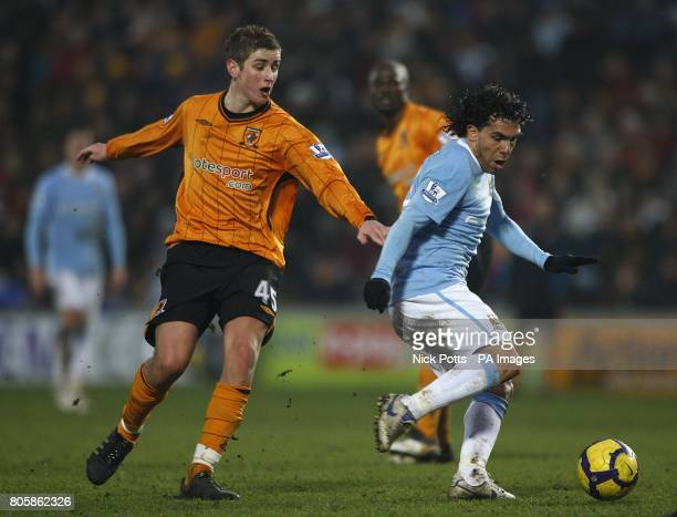 Hull City's Tom Cairney and Manchester City's Carlos Tevez battle for the ball