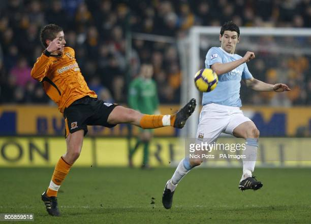 Hull City's Tom Cairney and Manchester City's Gareth Barry battle for the ball
