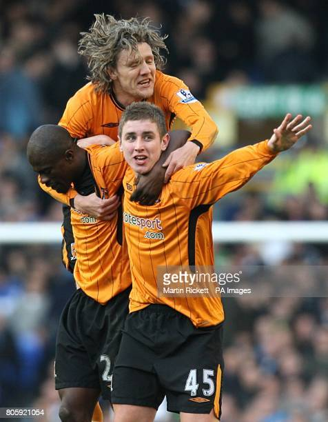 Hull City's Tom Cairney celebrates scoring their first goal with team mates Jimmy Bullard and George Boateng