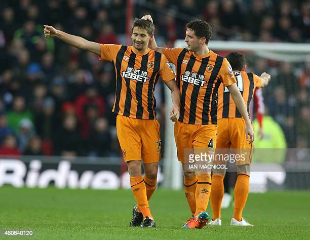 Hull City's Uruguayan midfielder Gaston Ramirez is congratulated by Hull City's Northern Irish defender Alex Bruce after he scores their first goal...