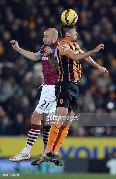 Hull City's Uruguayan midfielder Gaston Ramirez vies for the ball with Aston Villa's Scottish defender Alan Hutton during the English Premier League...