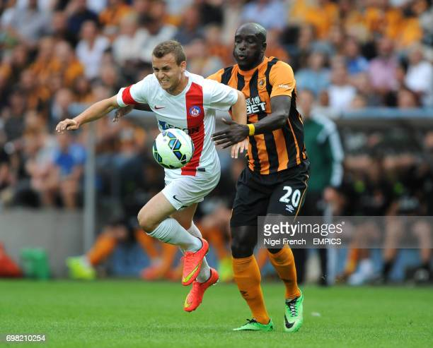 Hull City's Yannick Sagbo and Trencin's Stanislav Lobotka battle for the ball