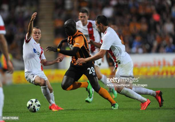 Hull City's Yannick Sagbo in action with AS Trencin's Frantisek Kubik and Stanislav Lobotka during the UEFA Europa League Qualifying Third Round...