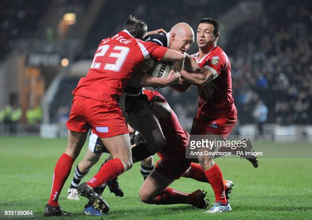 Hull FC's Craig Fitzgibbon is tackled by Crusaders' Peter Lupton and Lincoln Withers during the Engage Super League match at the KC Stadium Hull