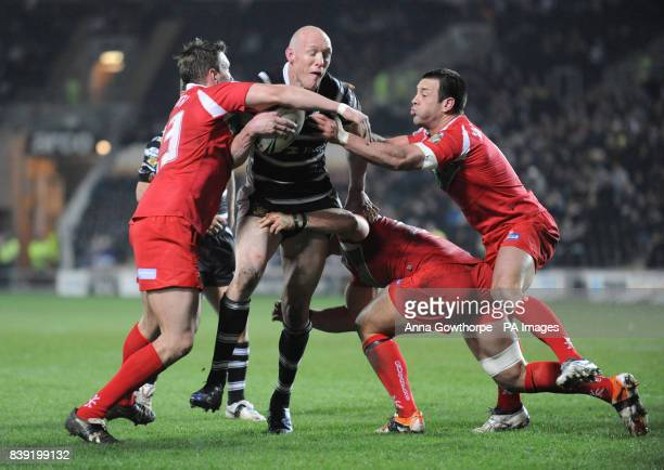 Hull FC's Craig Fitzgibbon is tackled by Crusaders' Peter Lupton Ben Flower and Lincoln Withers during the Engage Super League match at the KC...