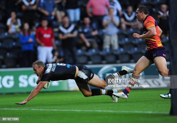 Hull FC's Daniel Holdsworth dives over to score a try during the Super League match at the KC Stadium Hull