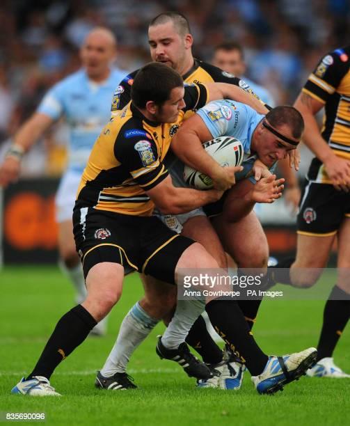 Hull FC's Danny Houghton is tackled by Castleford's Brett Ferres and Craig Huby during the engage Super League match at The Jungle Castleford