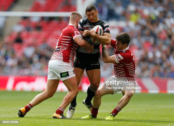 Hull FC's Mark Minichello is tackled by Wigan Warriors' John Bateman and Ryan Sutton during the Ladbrokes Challenge Cup Final at Wembley Stadium...