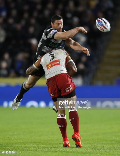 Hull FC's mark Minichiello and Catalans Dragons' Krisnan Inu during the Betfred Super League match at the KCOM Stadium Hull