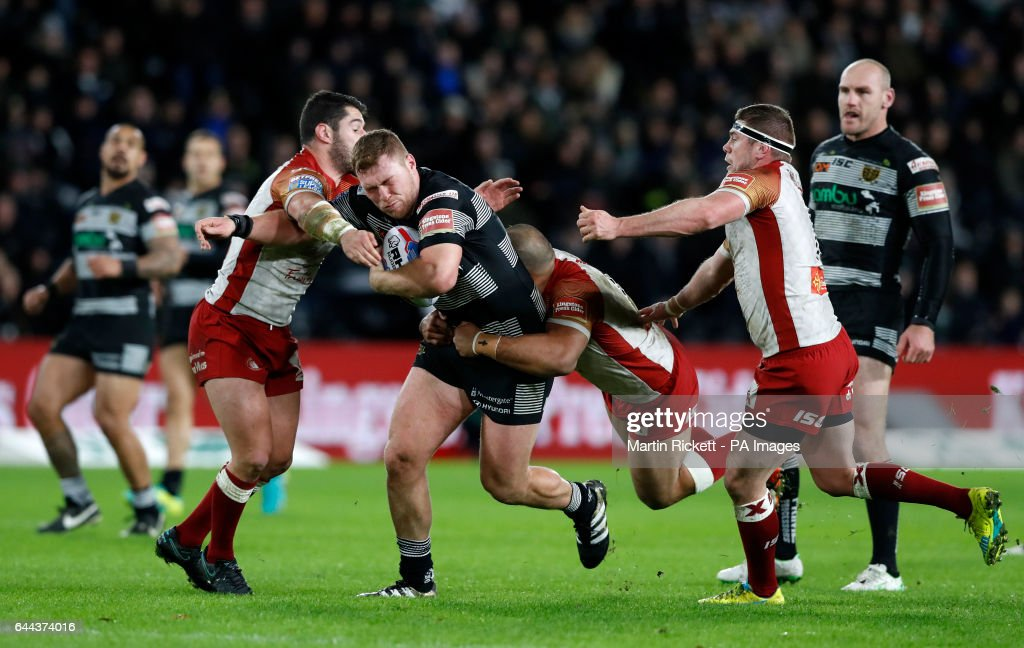Hull FC's Scott Taylor is tackled by Catalans Dragons' Ben Garcia and Sam Moa during the Betfred Super League match at the KCOM Stadium, Hull.