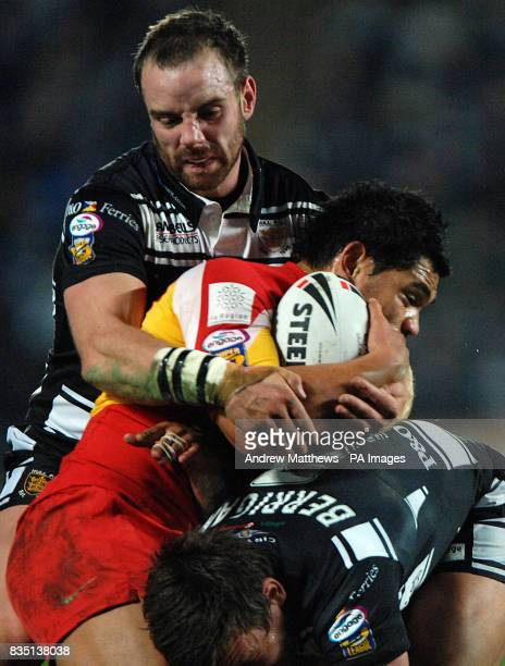Hull FC's Shaun Berrigan and Ewan Dowes combine to tackle Catalans Dragons' Dimitri Pelo during the engage Super League match at the KC Stadium Hull