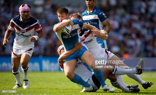 Hull FC's Tom Briscoe tackled by Wakefield's Richard Moore and Oliver Wilkes during the Carnegie Challenge Cup Semi Final at the Keepmoat Stadium in...