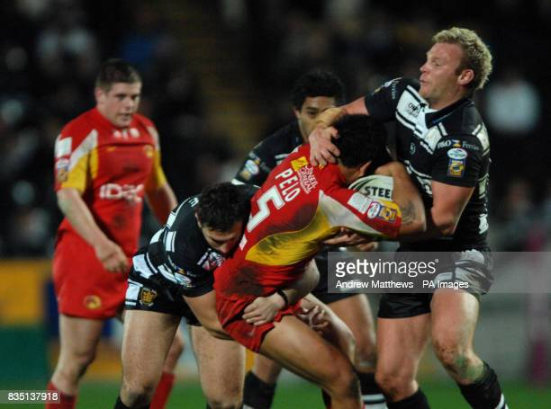 Hull FC's Tommy Lee and Jamie Thackray combine to bring down Catalans Dragons' Dimitri Pelo during the engage Super League match at the KC Stadium...
