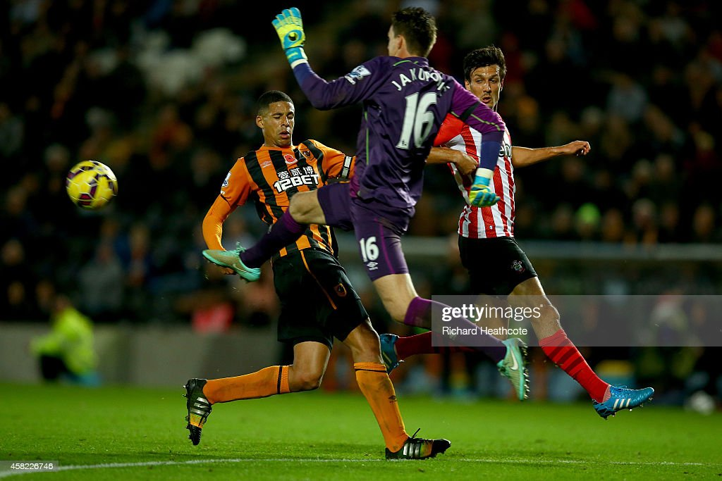 Hull goalkeeper <a gi-track='captionPersonalityLinkClicked' href=/galleries/search?phrase=Eldin+Jakupovic&family=editorial&specificpeople=724607 ng-click='$event.stopPropagation()'>Eldin Jakupovic</a> charges out to clear the ball past <a gi-track='captionPersonalityLinkClicked' href=/galleries/search?phrase=Curtis+Davies&family=editorial&specificpeople=647039 ng-click='$event.stopPropagation()'>Curtis Davies</a> of Hull and <a gi-track='captionPersonalityLinkClicked' href=/galleries/search?phrase=Jack+Cork+-+Soccer+Player&family=editorial&specificpeople=4206991 ng-click='$event.stopPropagation()'>Jack Cork</a> of Southampton during the Barclays Premier League match between Hull City and Southampton at the KC Stadium on November 1, 2014 in Hull, England.
