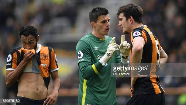 Hull goalkeeper Eldin Jakupovic reacts with captain Harry Maguire and Ahmed Elmohamady during the Premier League match between Hull City and...
