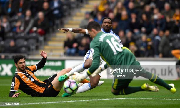 Hull goalkeeper Eldin Jakupovic saves a shot from Jermain Defoe of Sunderland during the Premier League match between Hull City and Sunderland at...