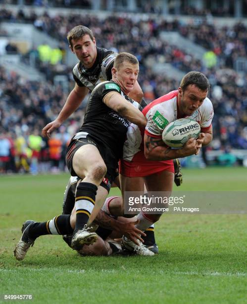 Hull Kingston Rovers' Josh Hodgson is held back from the try line by Hull FC's Richard Horne during the Super League match at the KC Stadium Hull