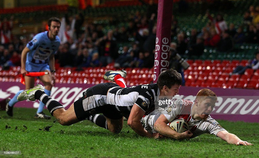 Hull KR player Kris Welham dives in to score during the Engage Super League Match between Hull Kingston Rovers and Hull FC at Millennium Stadium on...