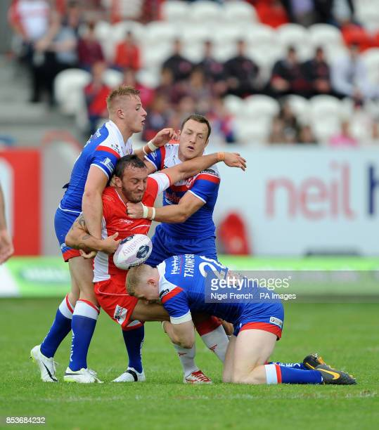 Hull KR's Josh Hodgson is tackled by St Helen's Greg Richards James Roby and Luke Thompson front during the First Utility Super League match at the...