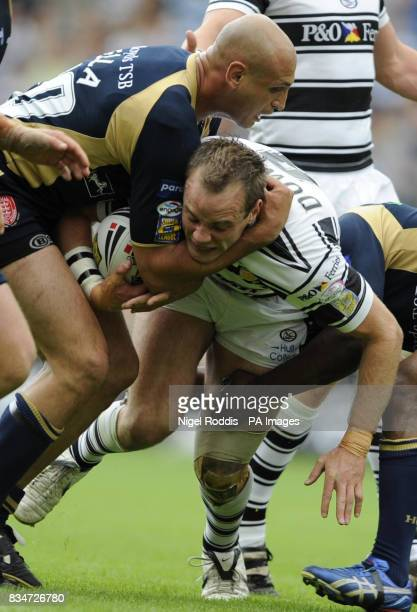 Hull KR's Mick Vellal tackles Hull FC's Ewan Dowes during the engage Super League match at the KC Stadium Hull
