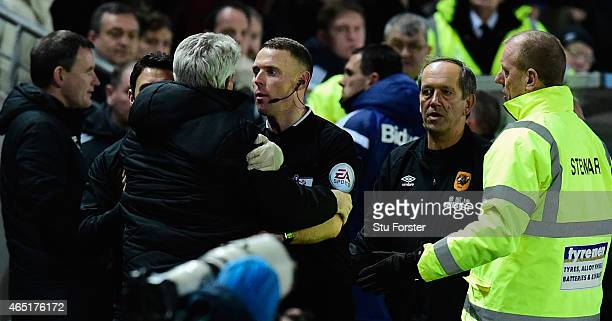 Hull manager Steve Bruce is held back by the assistant referee as Sunderland manager Gus Poyet is sent to the stand during the Barclays Premier...