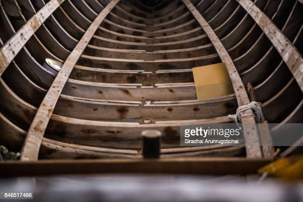 Hull of a Half-built wooden boat in a shipyard