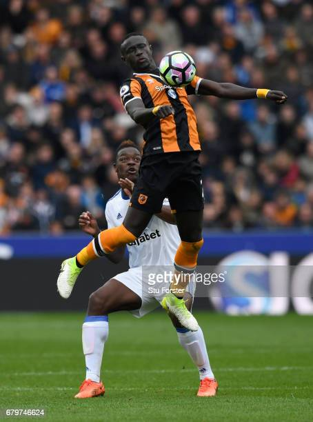 Hull player Oumar Niasse outjumps Lamine Kone of Sunderland during the Premier League match between Hull City and Sunderland at KCOM Stadium on May 6...