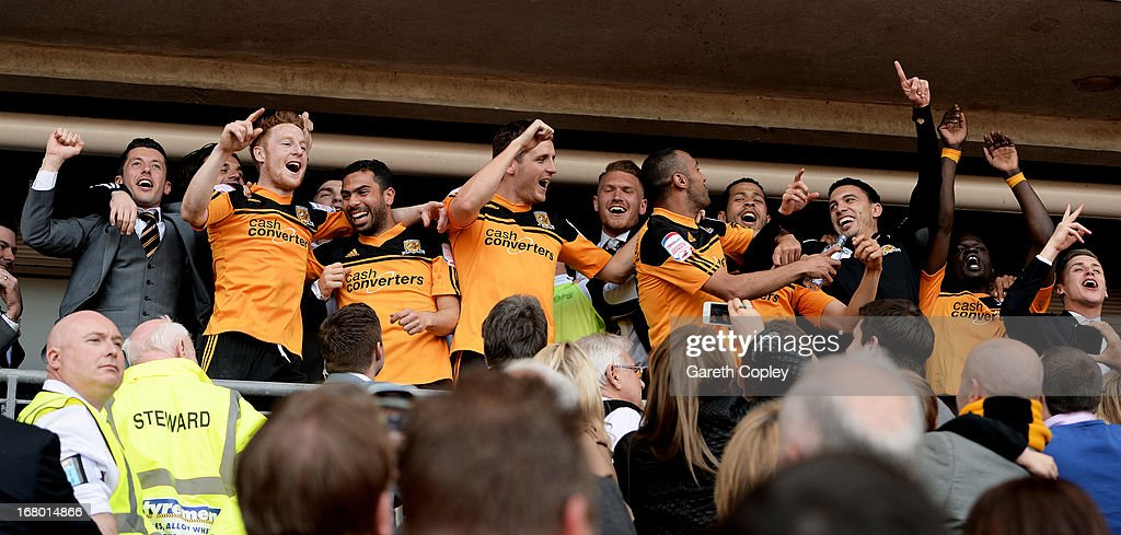 Hull players celebrate following their team's promotion to the Premier League during the npower Championship match between Hull City and Cardiff City...