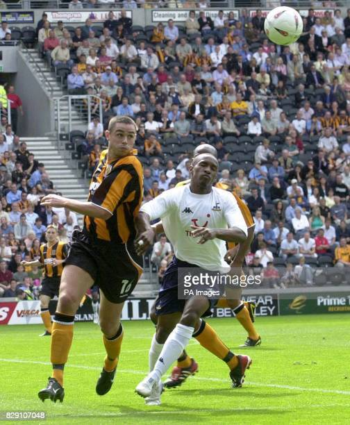 Hull's Damien Delaney heads clear under pressure from Spur's Jermain Defoe during the preseason friendly match at Boothferry Park Hull THIS PICTURE...