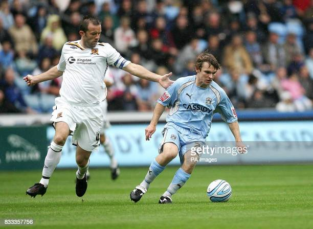 Hull's Ian Ashbee keeps tabs on Jay Tabb of Coventry during the CocaCola Football League Championship match at Ricoh Arena Coventry Picture date...