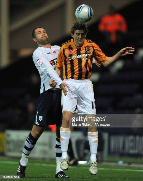 Hull's Kevin Kilbane wins a header over Preston's Jon Parkin during the npower Championship match at Deepdale Preston