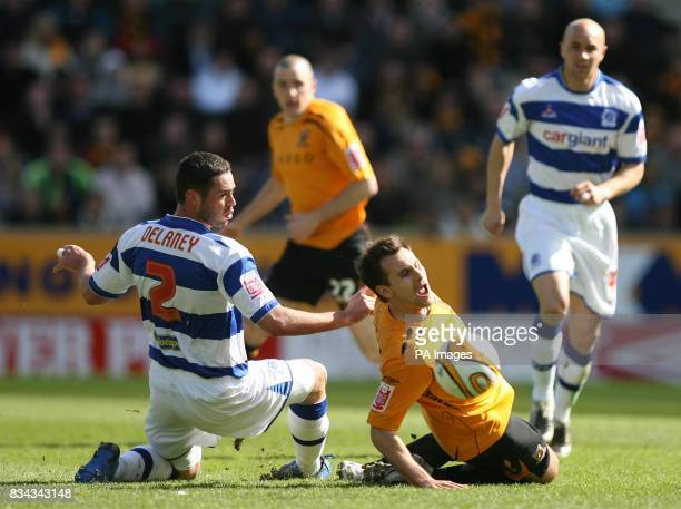 Hull's Richard Garcia is tackled by QPR's Damien Delaney during the CocaCola Championship match at Kingston Communications Stadium Hull