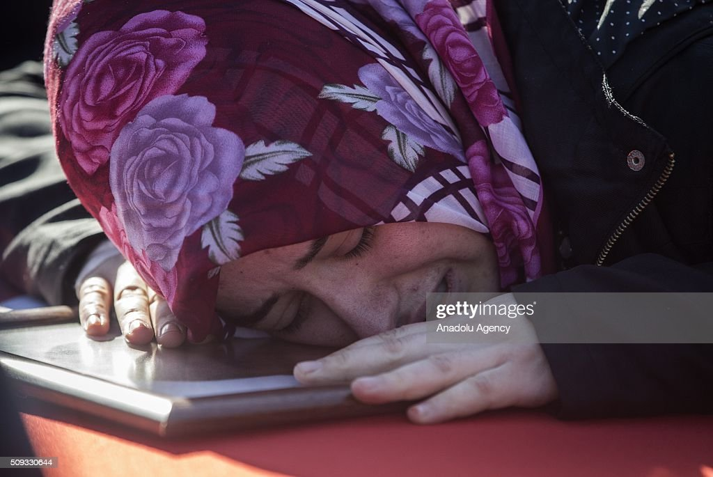 Hulya Gungordu, wife of Police officer Mehmet Gungordu who was martyred during an anti terror operation against PKK in Sirnak's Cizre, cries during a funeral ceremony at the 23. Border Division commandership of Gendarme forces in Sirnak, Turkey on February 10, 2016.