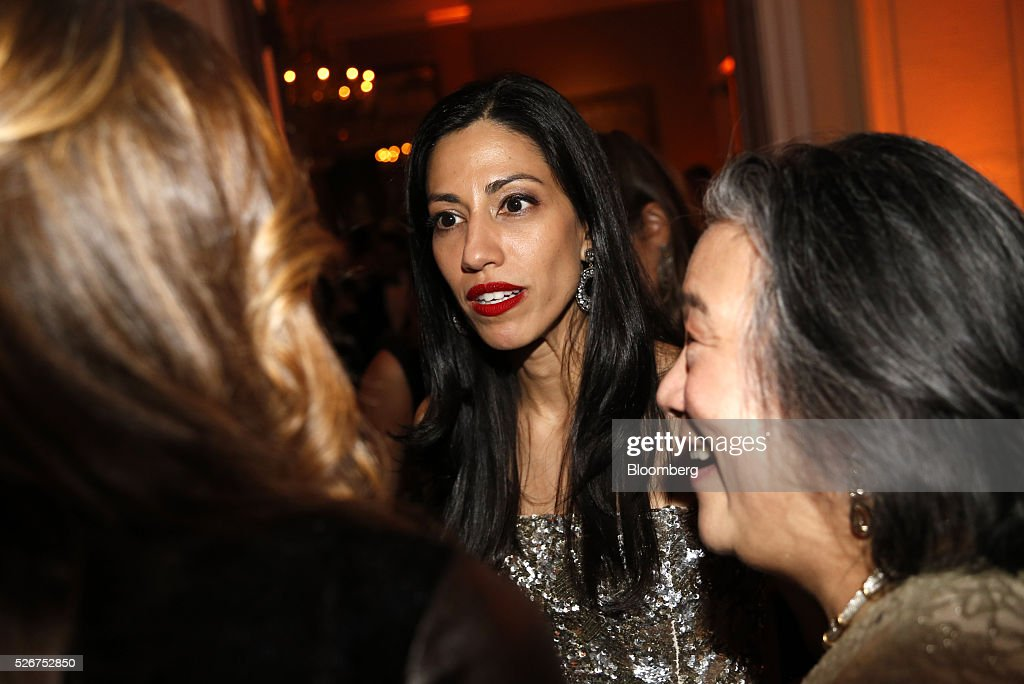 Huma Abedin, a longtime aide to former Secretary of State Hillary Clinton, center, attends the Bloomberg Vanity Fair White House Correspondents' Association (WHCA) dinner afterparty in Washington, D.C., U.S., on Saturday, April 30, 2016. The 102nd WHCA raises money for scholarships and honors the recipients of the organization's journalism awards. Photographer: Andrew Harrer/Bloomberg via Getty Images