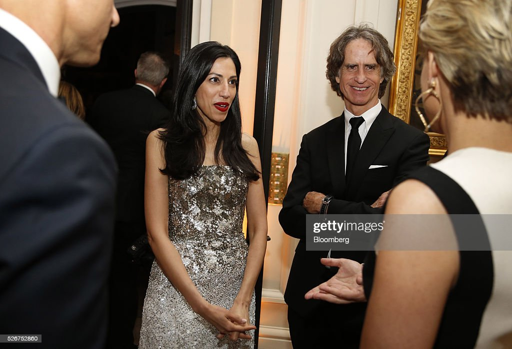 Huma Abedin, a longtime aide to former Secretary of State Hillary Clinton, center left, and director Jay Roach, center right, attend the Bloomberg Vanity Fair White House Correspondents' Association (WHCA) dinner afterparty in Washington, D.C., U.S., on Saturday, April 30, 2016. The 102nd WHCA raises money for scholarships and honors the recipients of the organization's journalism awards. Photographer: Andrew Harrer/Bloomberg via Getty Images