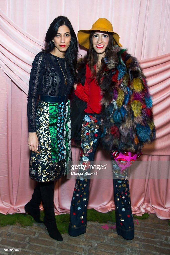 Huma Abedin (L) and Heba Abedin attend the Alice + Olivia by Stacey Bendet presentation during February 2017 New York Fashion Week at Highline Stages on February 14, 2017 in New York City.