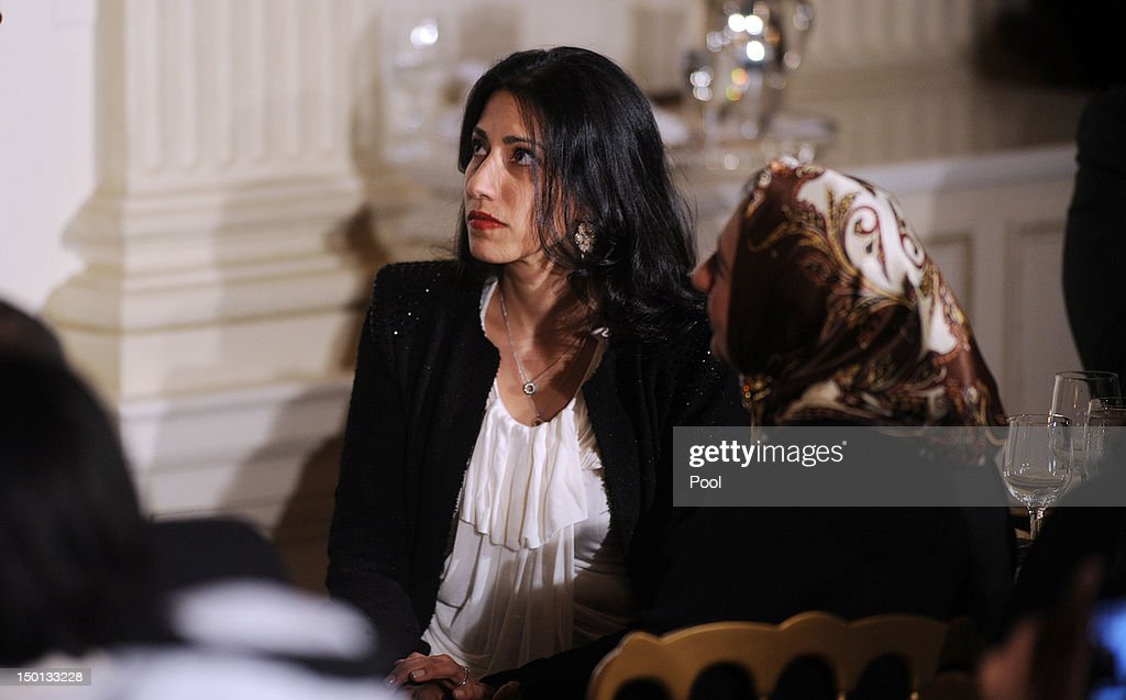<a gi-track='captionPersonalityLinkClicked' href=/galleries/search?phrase=Huma+Abedin&family=editorial&specificpeople=2807937 ng-click='$event.stopPropagation()'>Huma Abedin</a>, the Muslim wife of disgraced U.S. Rep. Anthony Weiner (D-NY), and who works as a top aide to Secretary of State Hillary Clinton, listens to President Barack Obama during an Iftar dinner celebrating Ramadan in the State Dining Room of the White House August 10, 2012 in Washington, DC. The invited guests include elected officials, religious and grassroots leaders in the Muslim American community, leaders of diverse faiths and members of the diplomatic corps .