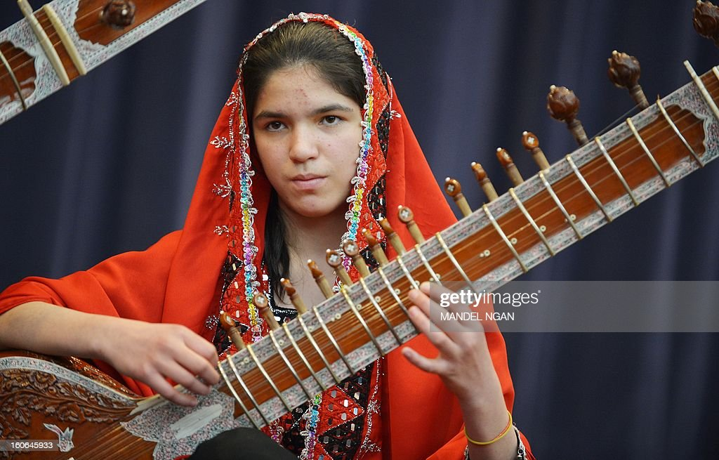 Huma Rahimy, of the Afghanistan National Institute of Music Sitar and Sarod Ensemble, performs in the Dean Aceson Auditorium on February 4, 2013 in Washington, DC. The performance kicks of a three-city tour of the US. AFP PHOTO/Mandel NGAN