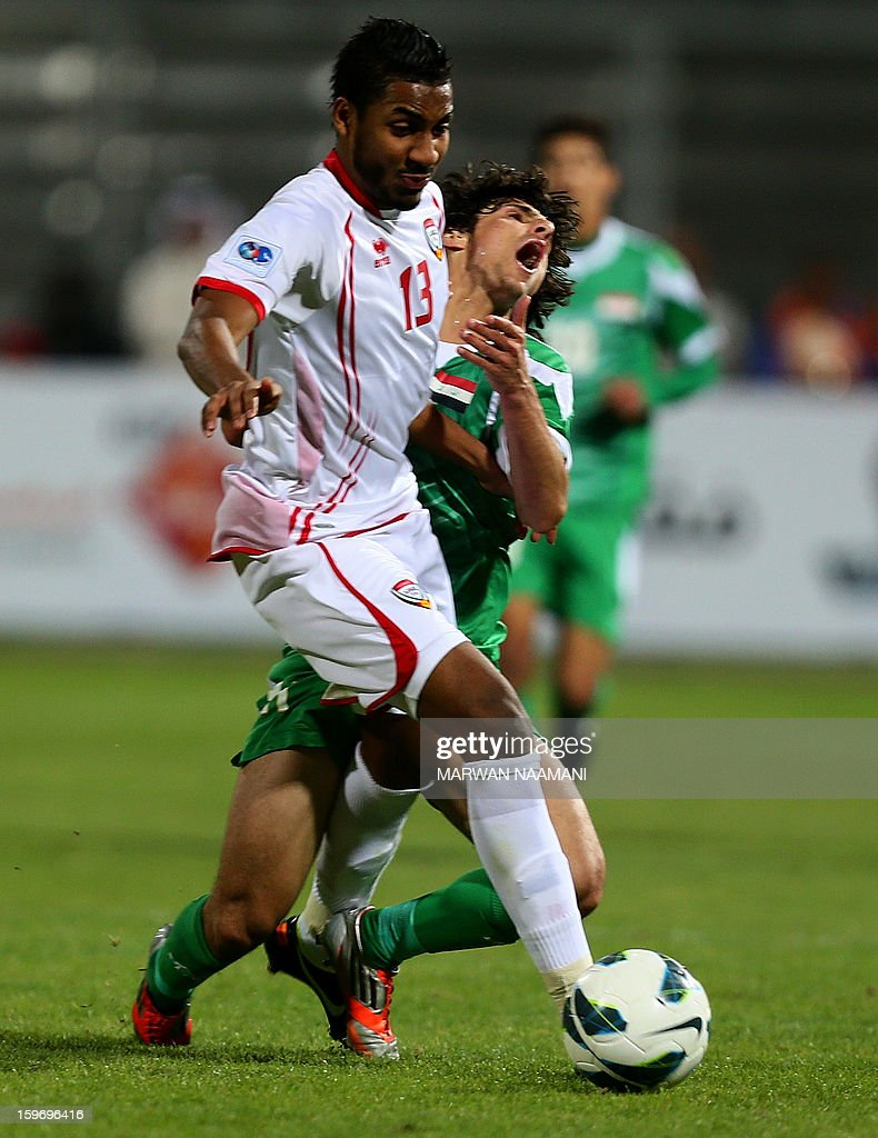 Humam Tariq Faraj (back) of Iraq vies with Khamis Ismail of UAE during the 21st Gulf Cup's final between United Arab Emirates (UAE) and Iraq on January 18, 2013 in Manama. United Arab Emirates won 2-1 against Iraq.