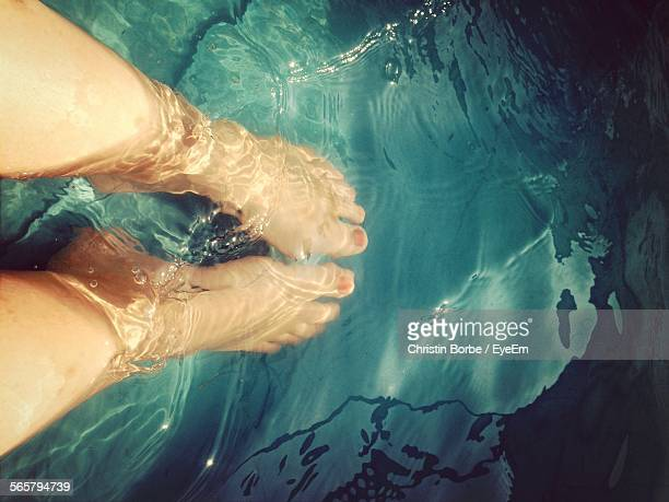 Human Ankle Deep In Transparent
