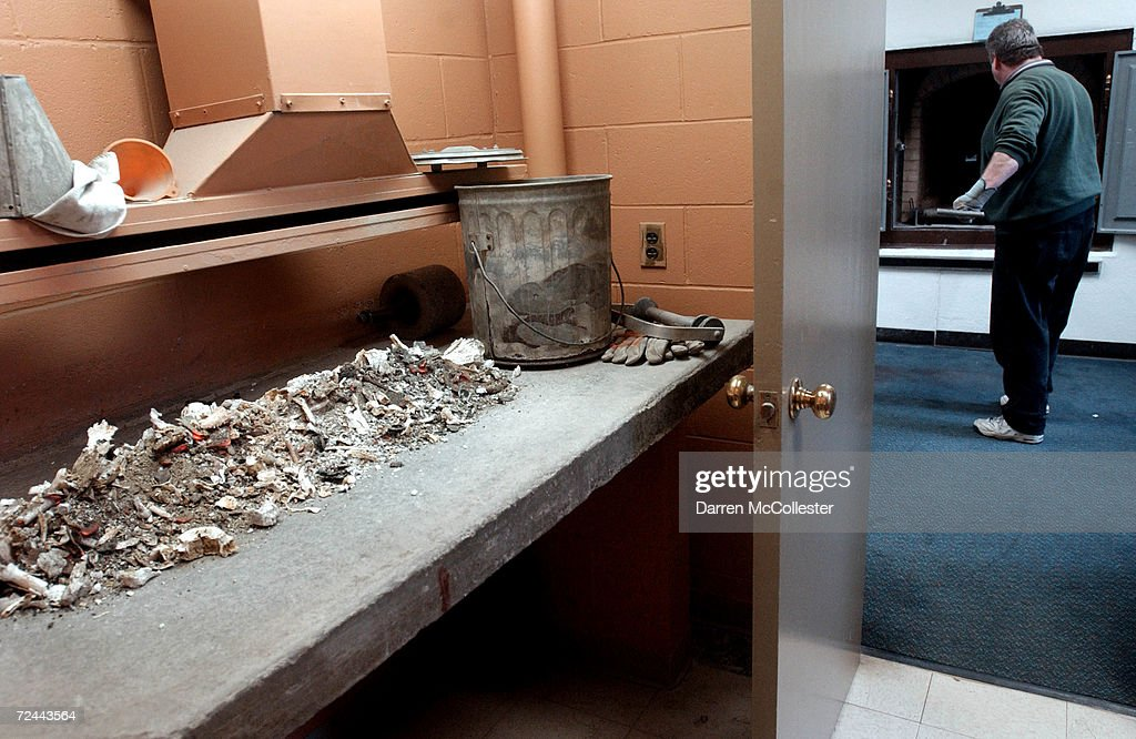 Human ashes cool as crematory operator Joe Bancewicz prepares a retort or cremation ovens at Mount Auburn Cemetary February 21 2002 in Watertown MA...