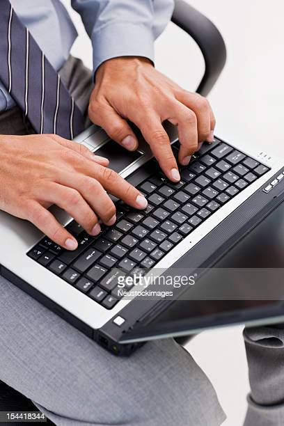 Human being typing on laptop