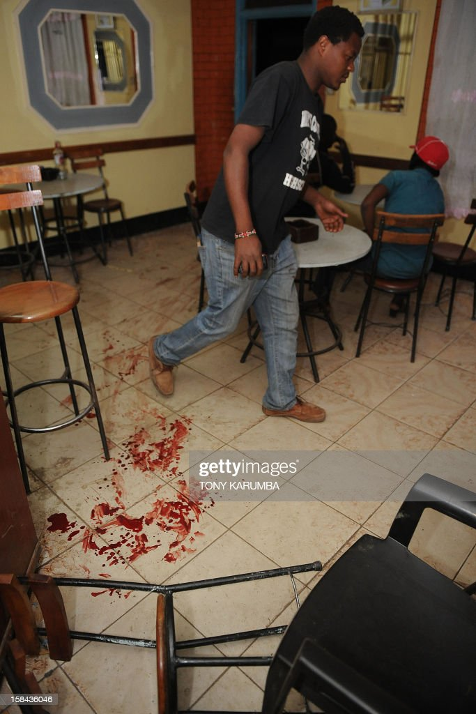 Human blood stains the floor of a local bar and restaurant following a grenade explosion on December 16, 2012 in Nairobi's mainly Somali ethnic neighbourhood of Eastleigh. A huge blast shook the predominantly Somali neighbourhood of Eastleigh in the Kenyan capital Nairobi this evening after three grenades targeted at a local bar and restaurant were lobbed injuring at least two people, police said. Witnesses say there were at least three separate blasts and that the explosions occurred near a bar, which follows another recent grenade attack outside a mosque in the same neighbourhood that killed at least five people as well as wounding the local member of parliament. AFP PHOTO/Tony KARUMBA
