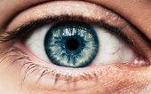 Human blue eye closeup macro