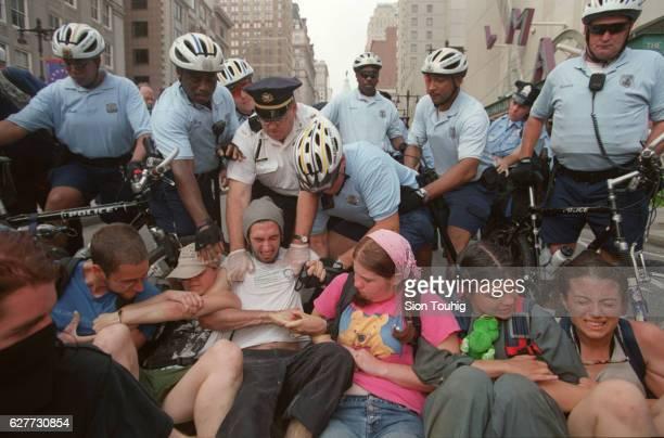 'Human chain' and arminarm demonstrators block Broad Steet in Philadelphia